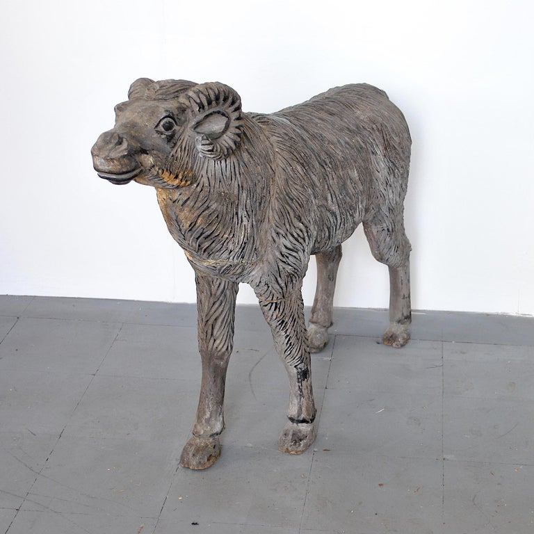 Finely refined natural size wood sculpture depicting a mutton.