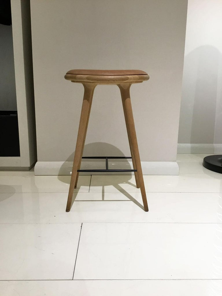 The Mater High stool is designed by the Danish architect duo Space Copenhagen and is regarded as a New Danish Classic. With its organic yet Minimalist style, this bar stool is suitable for both residential and commercial use.   Design Space