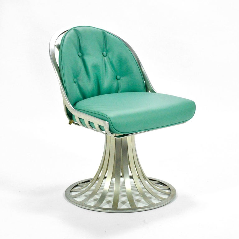 A beautiful design and a great occasional piece, this aluminum chair by Woodard has a wonderful sculptural quality and is in great original vintage condition including the turquoise vinyl upholstery. The materials make it function equally well