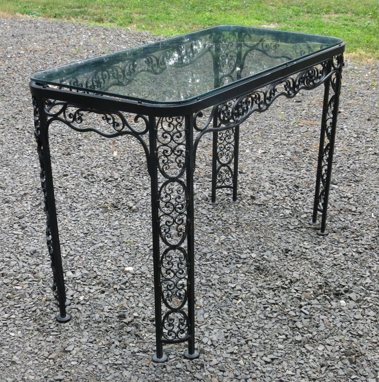 Woodard Andalusian pattern patio table. Table has a few chips to the paint, and glass has a few scratches and a chip to one corner. Complimentary piece to the white dining set that is listed. Rare to find. It is 20.5