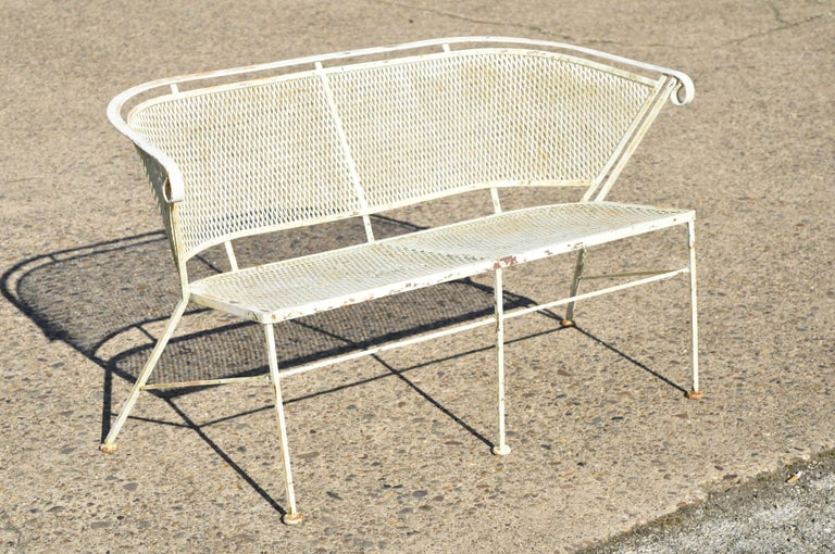 Woodard vintage midcentury wrought iron barrel back garden patio bench loveseat. Item features barrel back, metal mesh back and seat, wrought iron construction, very nice vintage item, great style and form, circa mid-20th century. Measurements: 29