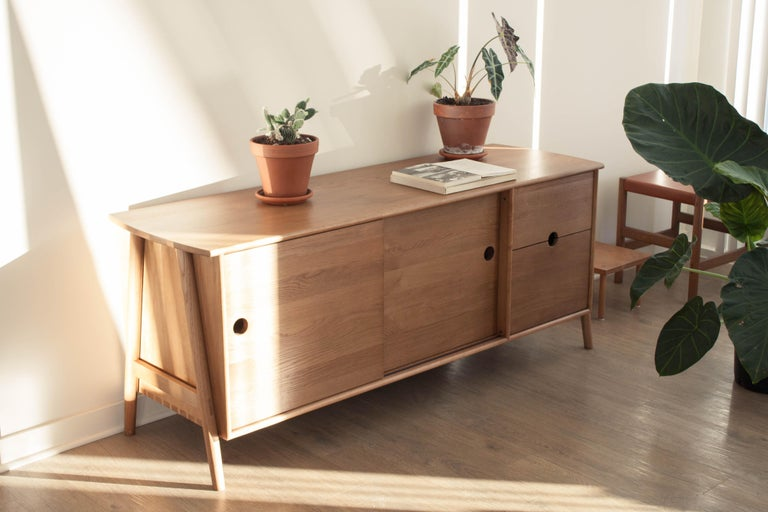 Sun at six is a Brooklyn design studio. We work with traditional Chinese joinery masters to handcraft our pieces using traditional joinery. The woodbine sideboard features dovetails and traditional joinery throughout.  • Solid white oak • Tung