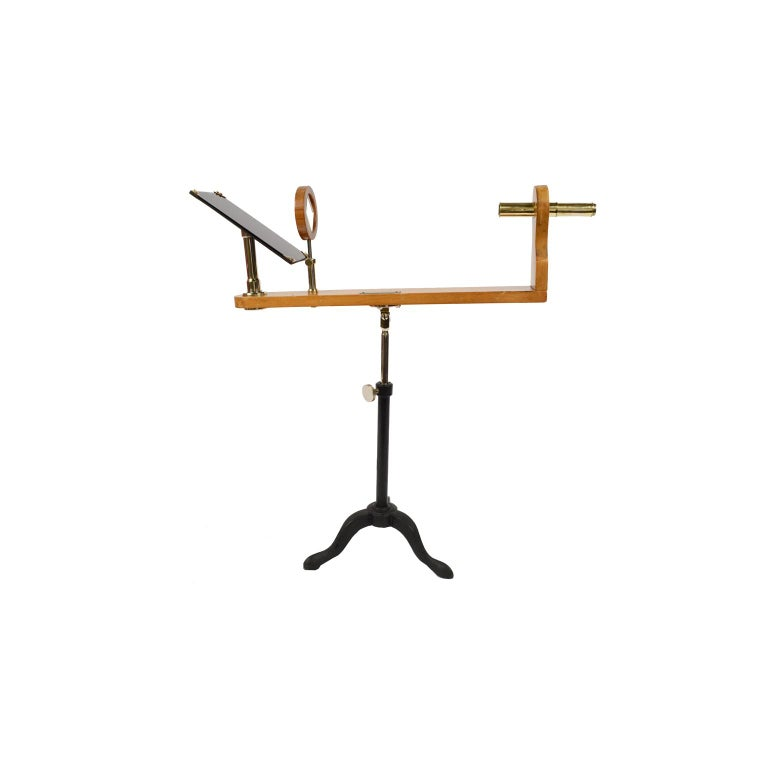 Wooden and brass polarimeter with cast iron tripod base from the late 1800s. It is an instrument used to determine the concentration of sucrose and glucose in raw materials and sugar-based food products. Very good condition and in perfect working