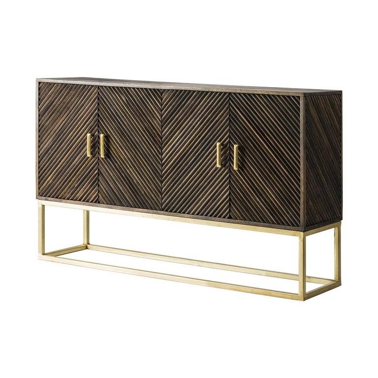 Wooden sideboard with sleek design, gild patina metal and subtle work of panels doors.