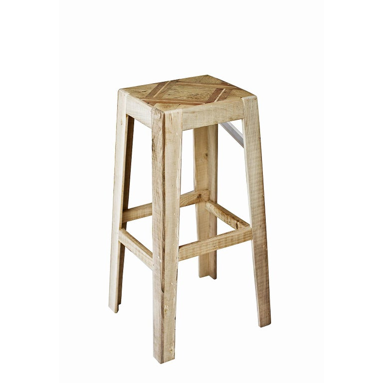 The bar stool is made of an antique piece of walnut wood floorboard, handcrafted Elmwood, and Plexiglass. The footrest heights are all different to accommodate all ages and heights.   Materials: Nut and Elm Wood, Plexiglass and Screws of Brass.