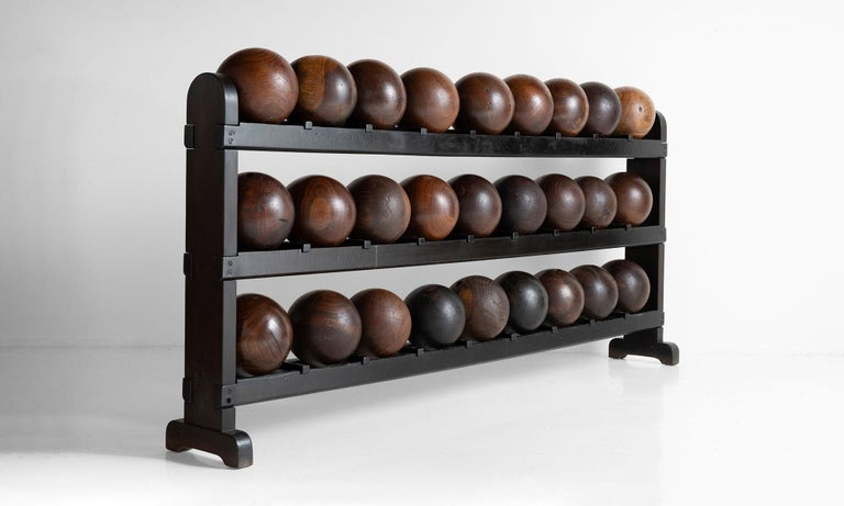 """Painted three tiered rack with (27) balls.   Rack: 84.5"""" W x 11"""" D x 37.75"""" H   Bowling Balls:  approx. 8"""" diameter."""