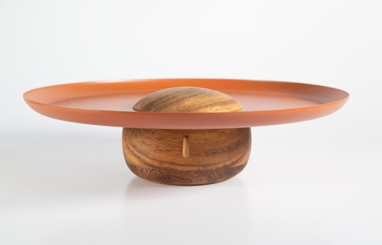 Trays inspired by the Mexican baker, a union of the basket and the head results in this piece. Made  of parotta wood and electropainted steel.  Dimensions high tray: 14.5 H x 9 W x 23 Dm cm / 5.7 H x 3.5 W x 9 Dm in  Dimensions low tray: 8.5 H