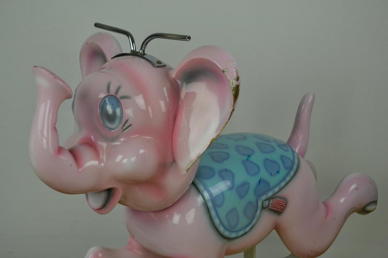 Carousel Elephant Sculpture by Bernard Kindt, a Belgian sculptor who is known for making Wooden Carnival Animals. This cute pink elephant ride on is made from wood and stands on an iron base. This Carousel Animal dates from the 1960s, gave a lot of