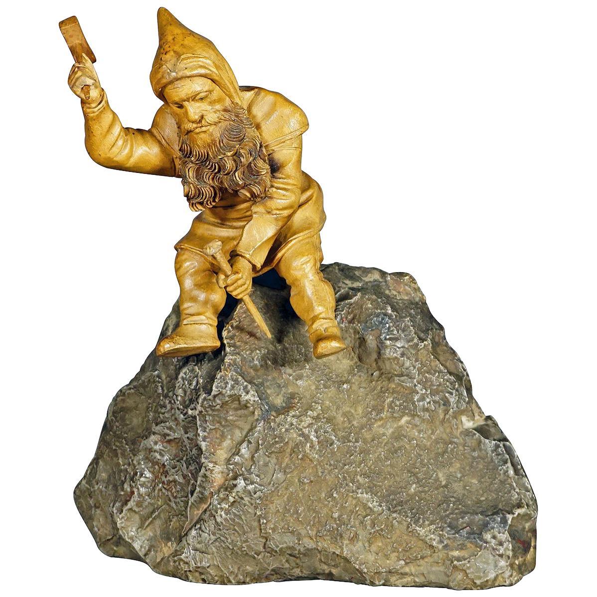 Wooden Carved Black Forest Dwarf Sitting on a Rock