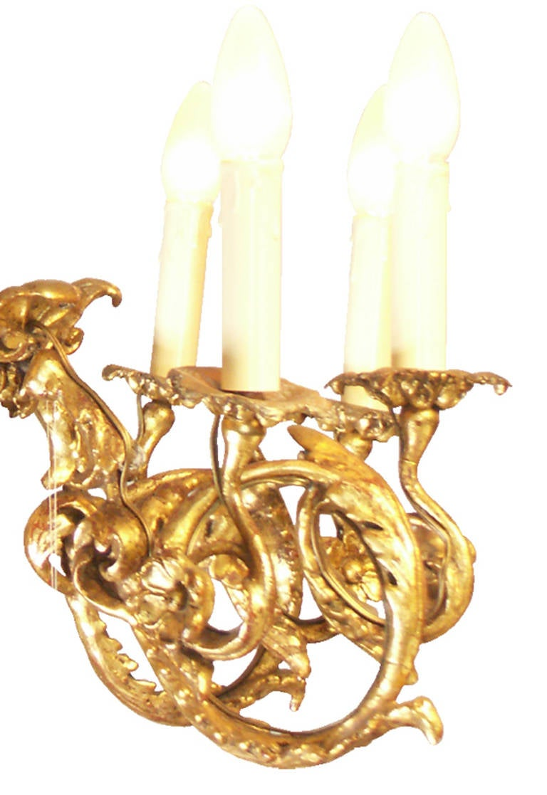 Wooden chandelier, carved and gilded, circa 1920, eight candles, very nice work, restored by Woka Vienna Carved lime wood, gilded surface.