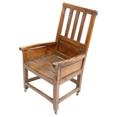 Wooden Chair with Carvings on Brass Casters