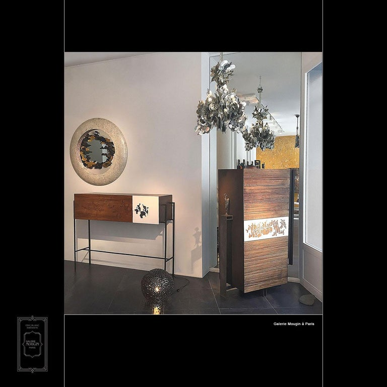 This is a beautiful cupboard with interior shelves handmade and designed in France by Eric Blanc. The front is covered with a unique artwork by artist Gaetan de Seguin. It is a captivating piece of furniture, elegant and minimalistic in its design.
