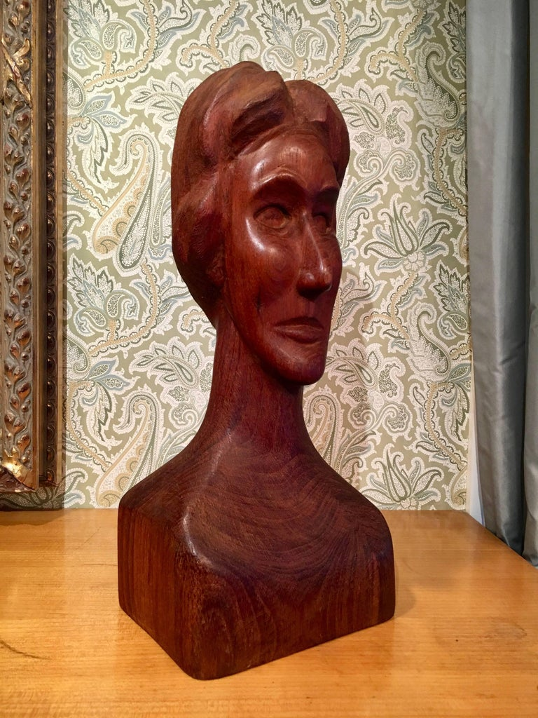 Wooden Folk Art sculpture of a woman - very well done with subtle, yet well detailed and implied offerings of a stern woman's face. Could easily be displayed on it's own pedestal or, better yet, as a definitive piece gracing a shelf, console or