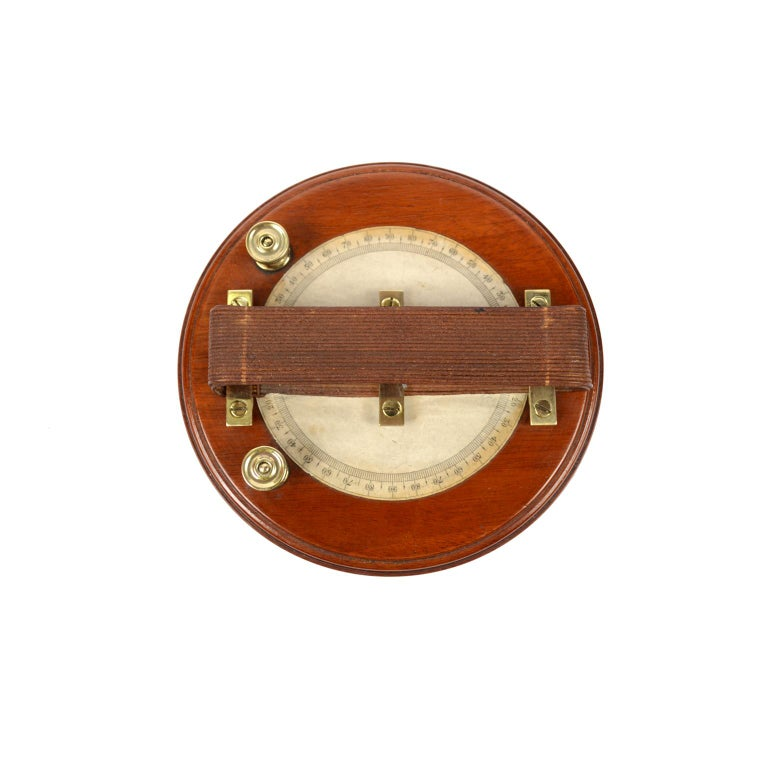 Astatic galvanometer by Elliott of the mid-19th century, mounted on a turned wooden base. It is an instrument used to measure weak currents. The instrument consists of a coil, a graduated scale placed under the circular coil, an astatic system