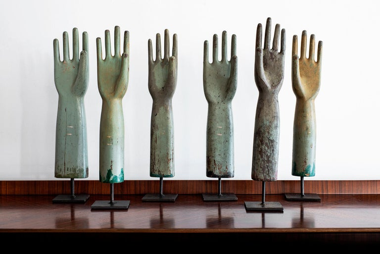 Vintage wooden glove molds Displayed on iron bases Priced individually.