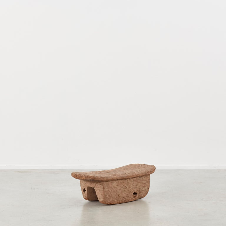This ancient meditation stool is crafted from a lovely weathered piece of hardwood. Its simple form is given life by the depth of grain, surface cracks and patina throughout. It would lend itself well to being used for a wide array of interior and
