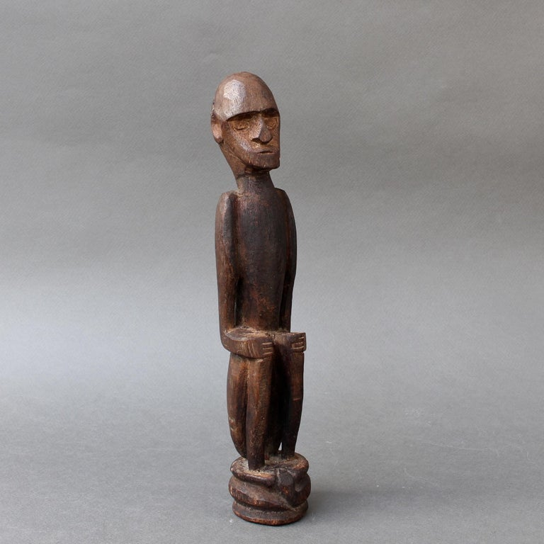 Indonesian Wooden Sculpture or Carving of Sitting Figure from Sumba Island, Indonesia For Sale