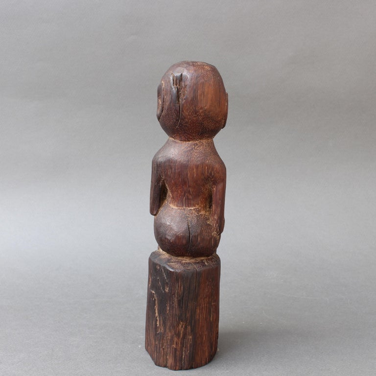 Wooden Sculpture or Carving of Sitting Figure from Sumba Island, Indonesia In Good Condition For Sale In London, GB