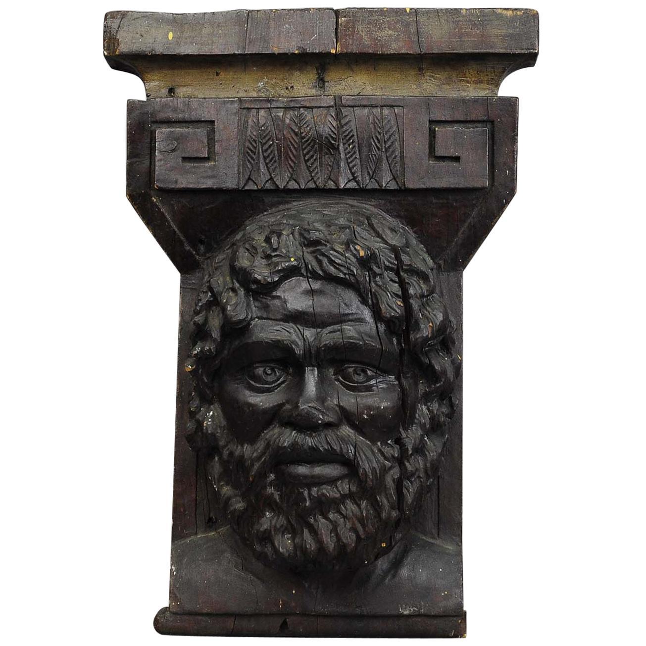 Wooden Sculpture of a Masculine Face