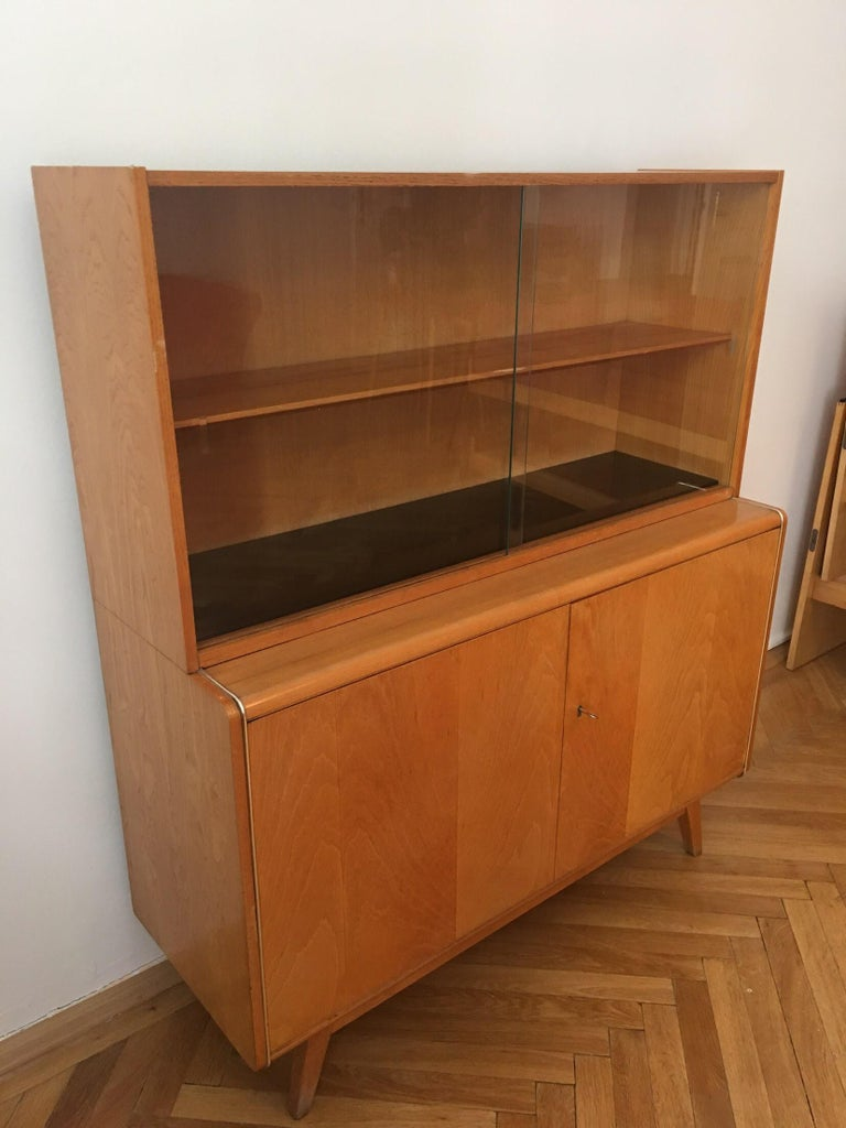 Sideboard with Bookcase from 1960s – like a brand new. Perfect condition. Made in Czechoslovakia in town Sobeslav – brand Jitona.  Designer Bohumil Landsman, Hubert Nepozitek Measures: Length: 118 cm Width: 43 cm Height: 136 cm.
