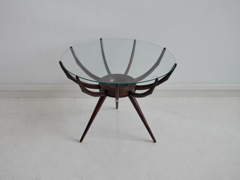 Coffee table with wooden base and round transparent glass top designed by Carlo De Carli in the 1950s, Italy. The table's wooden structure reminds insect legs, therefore the name