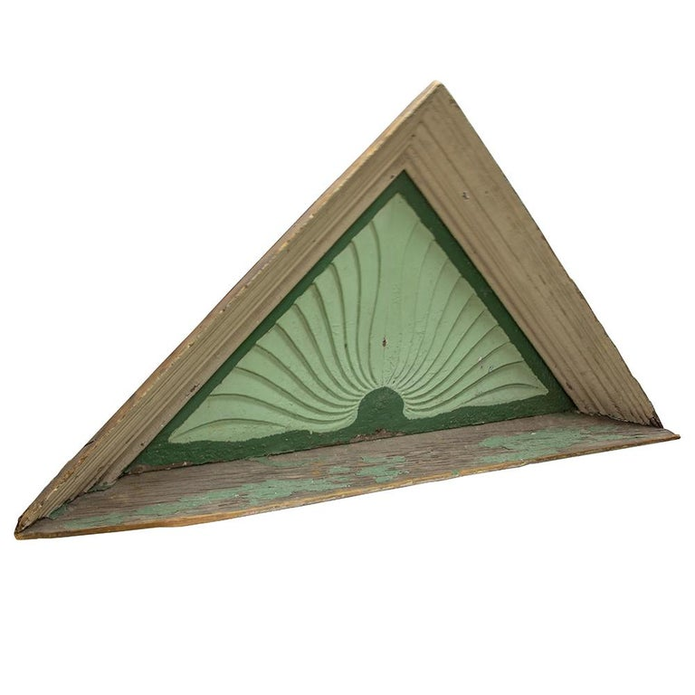 This beautiful architectural piece has a sculptural quality in the gentle undulation of its radiating linear design and is painted in contrasting shades of cool green.