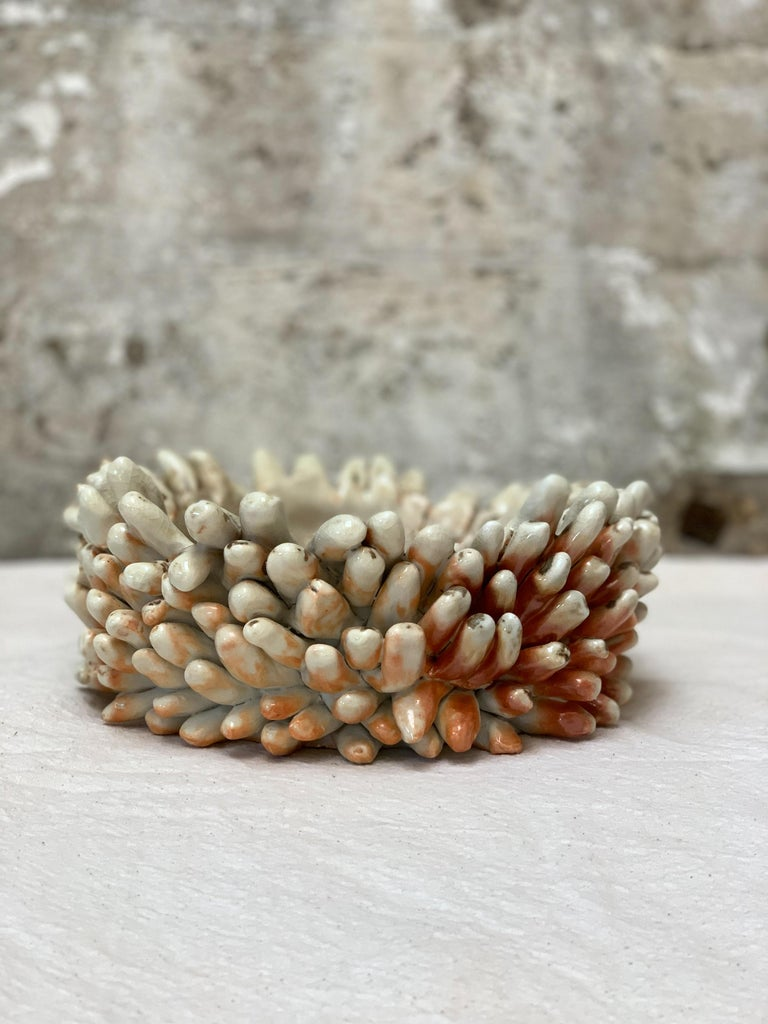 """Wood-fired porcelain bowl composed of hundreds of clay balls rolled into shape one at a time, then individually applied. A labor of love.  Dimensions variable, approximately 4 x 8""""  Due to the nature of wood-fired ceramics, the bowl you receive"""