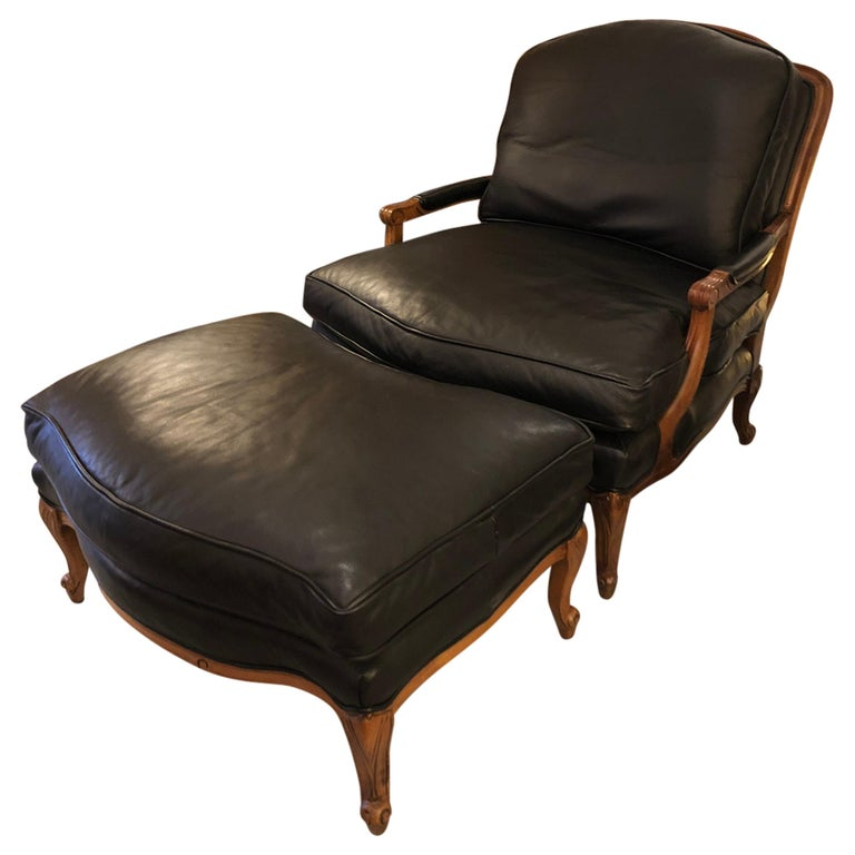 Woodward & Lothrop Top of the Line Black Leather and Walnut Club Chair & Ottoman For Sale