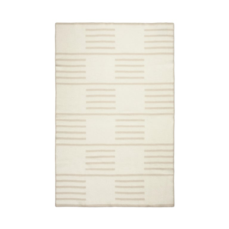 A traditional design inspired by classic Scandinavian patterns. It will look as stunning both in full and when folded or thrown over your furniture. The blanket is woven to be as beautiful on the back as the front but with inverted colors on each
