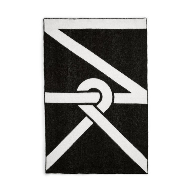 Our logo design creates a bold pattern that looks stunning both in full and when folded or thrown over your furniture. The blanket is woven to be as beautiful on the back as the front but with inverted colors on each side.