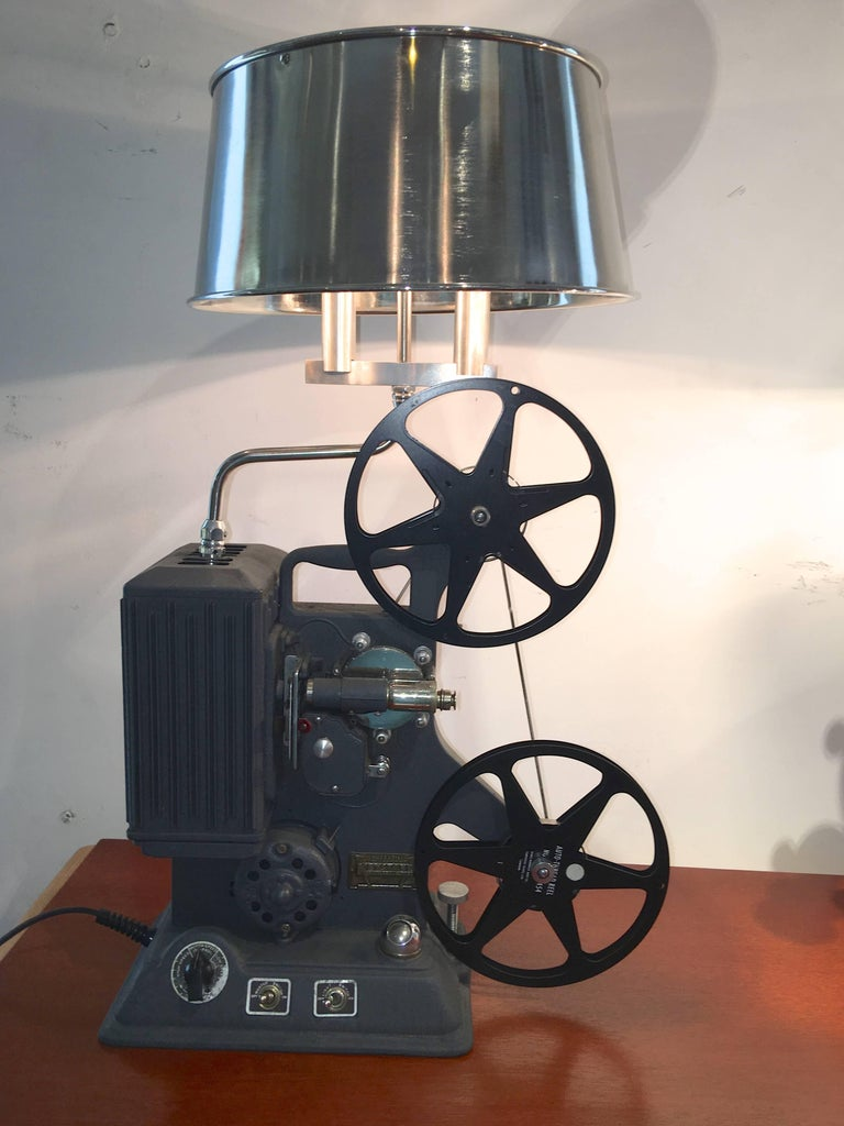Fully operational 1939 Model R-8 8mm film projector by Keystone Manufacturing Company of Boston, MA which has been converted into a table lamp with machined and polished aluminum hardware and lamp works and a polished stainless steel lampshade.