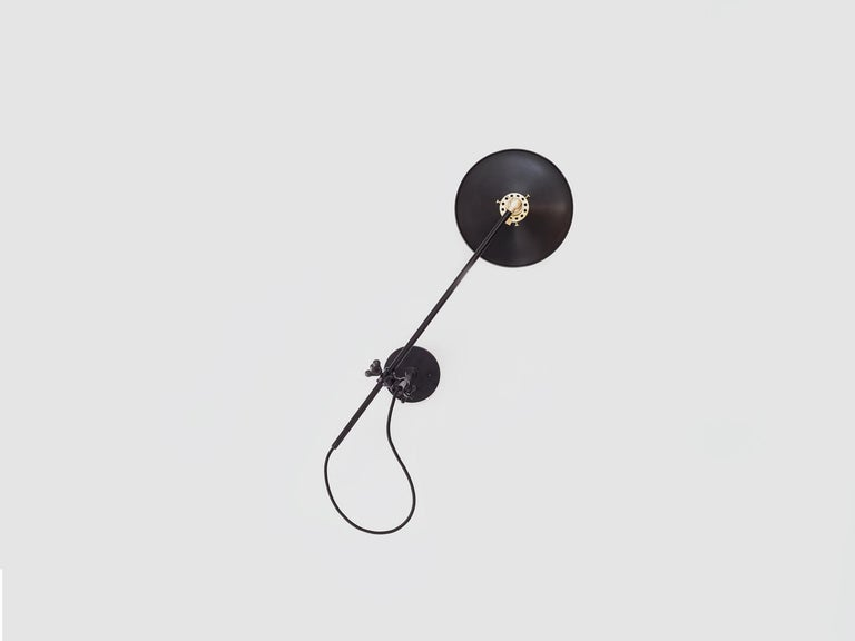 American Workstead Hardwired Wall Lamp in Black with Adjustable Painted Brass Shade For Sale