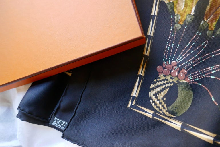 "World Famous Hermes Silk Scarf ""Brazil"" by Laurence Bourthoumieux, 2001  Beautiful un worn original Vintage Hermes Silk Scarf, in Black Silk Twill   This is an exquisite and well loved design, one for the enthusiast and collector of both Scarves or"