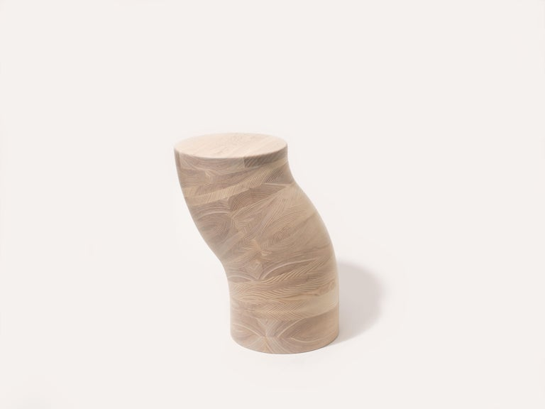 The worm side table is handcrafted out of solid Ash. The Worm Side table is built by laminating tapered layers of ash, then hand carving into shape. Each Worm is unique as each has it's own curvature and wiggle. The base is weighted to aid in