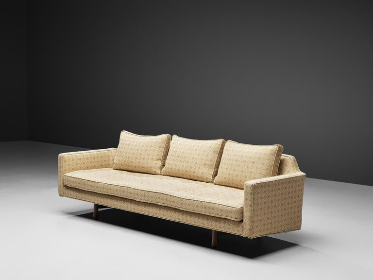 Edward Wormley for Dunbar, sofa '495', fabric and mahogany, United States, 1955  A very elegant three-seat sofa by Edward Wormley. The sofa has a more classic design compared to other designs by the designer. The sofa is supported by a frame that