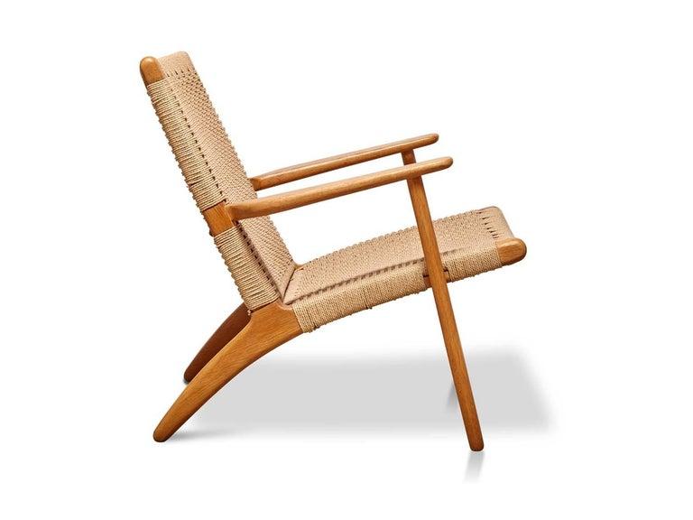 Woven CH25 chair by Hans Wegner for Carl Hansen & Son.