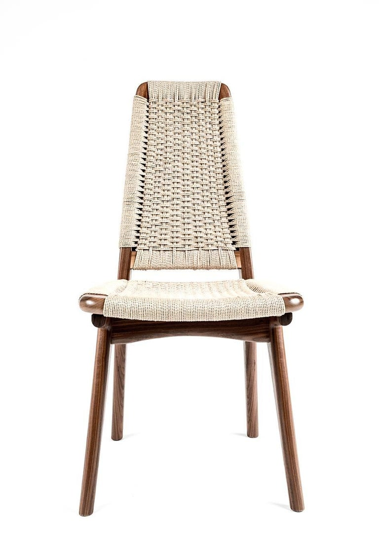 Mid century inspired, hardwood and Danish weave dining or office chair. Can be made with any domestic or exotic hardwood of your choosing. Taking Rian to new heights. All the beauty and sophistication of our Rian collection realized in a new high
