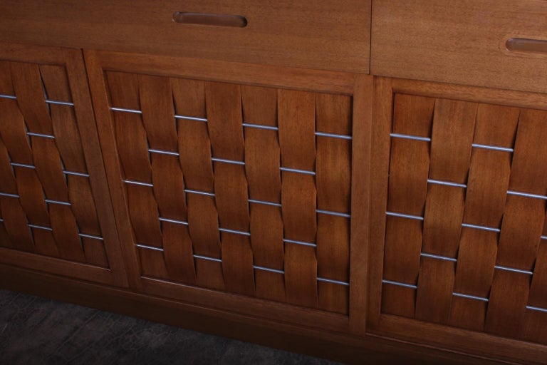 A bleached mahogany woven front credenza designed by Edward Wormley for Dunbar.