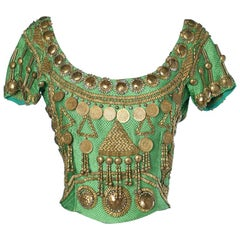 Woven green silk top embroidered with pearls and gold pieces Gianni Versace