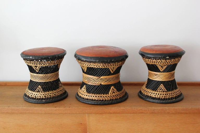Ethnic woven rattan, wicker and leather stools.