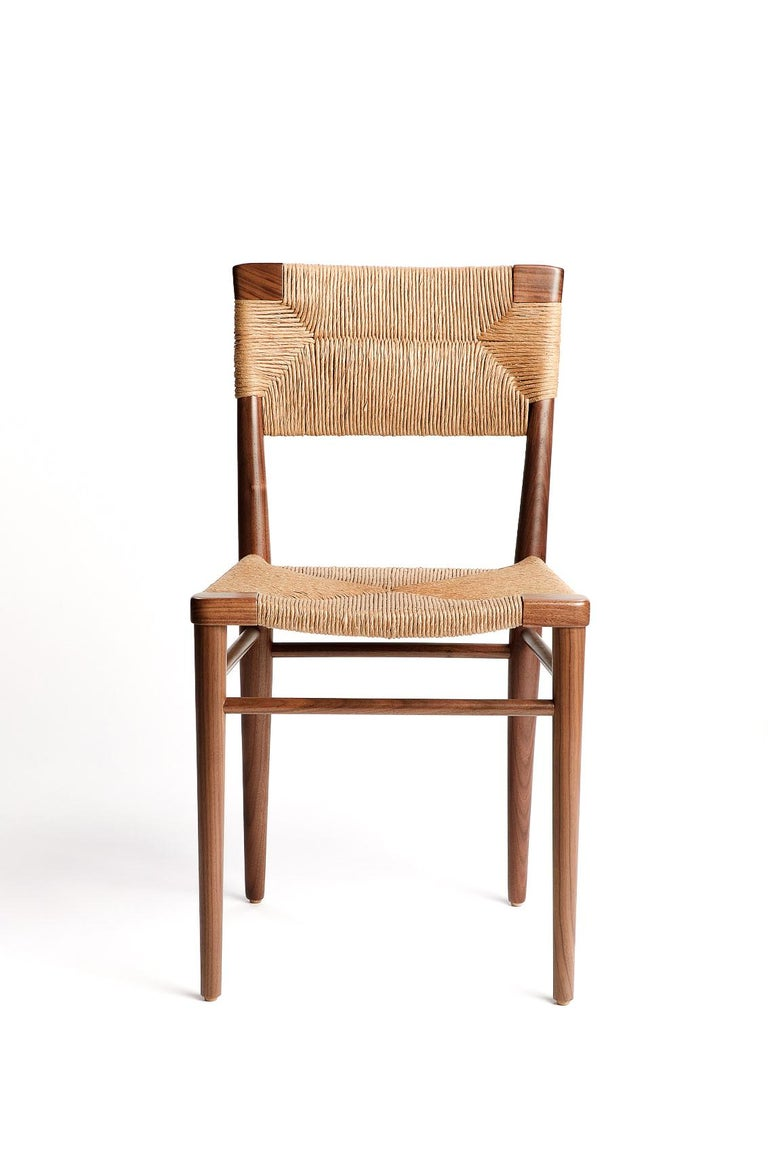 Originally designed by Mel Smilow in 1956 and officially reintroduced by his daughter Judy Smilow in 2018, the woven rush dining side chair is classically midcentury. This collection's handwoven seating and handcrafted wooden frame provide a