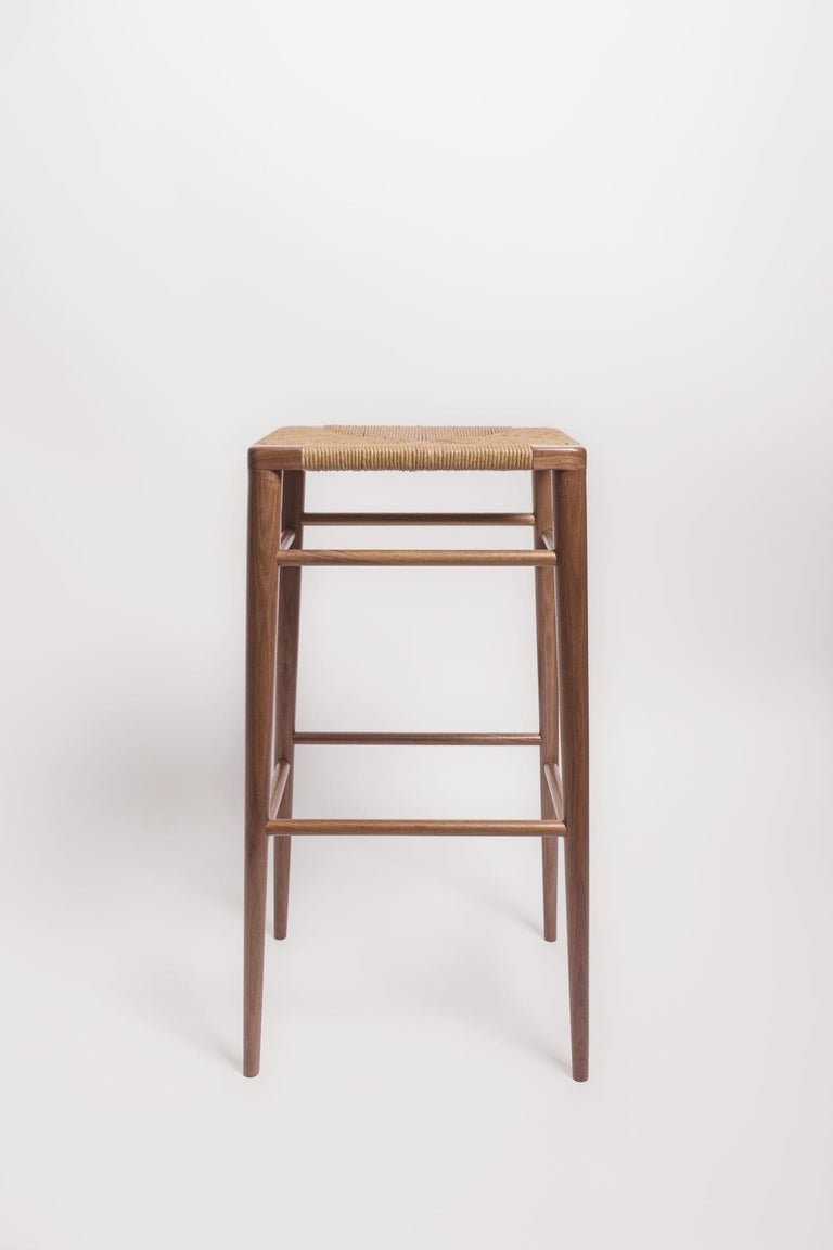 Originally designed by Mel Smilow in 1956 and officially reintroduced by his daughter Judy Smilow in 2013, the Woven Rush Bar Stool is classically midcentury. This collection's handwoven seating and handcrafted wooden frame provide a comfortable and