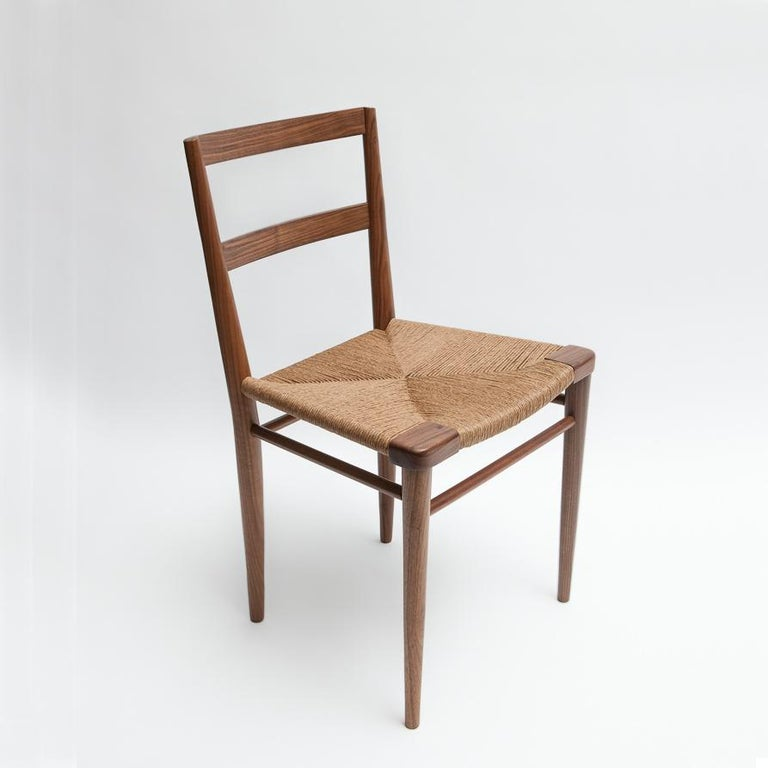 Originally designed by Mel Smilow in 1956 and officially reintroduced by his daughter Judy Smilow in 2013, the woven rush dining side chair is classically midcentury. This collection's handwoven seating and handcrafted wooden frame provide a