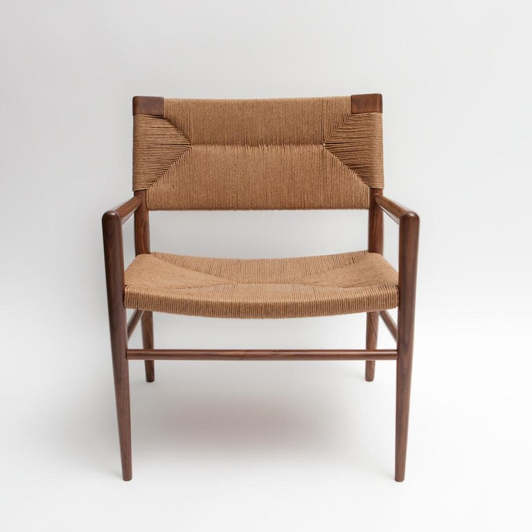Originally designed by Mel Smilow in 1956 and officially reintroduced by his daughter Judy Smilow in 2013, the Woven Rush Lounge Chair is classically midcentury. This collection's handwoven seating and handcrafted wooden frame provide a comfortable
