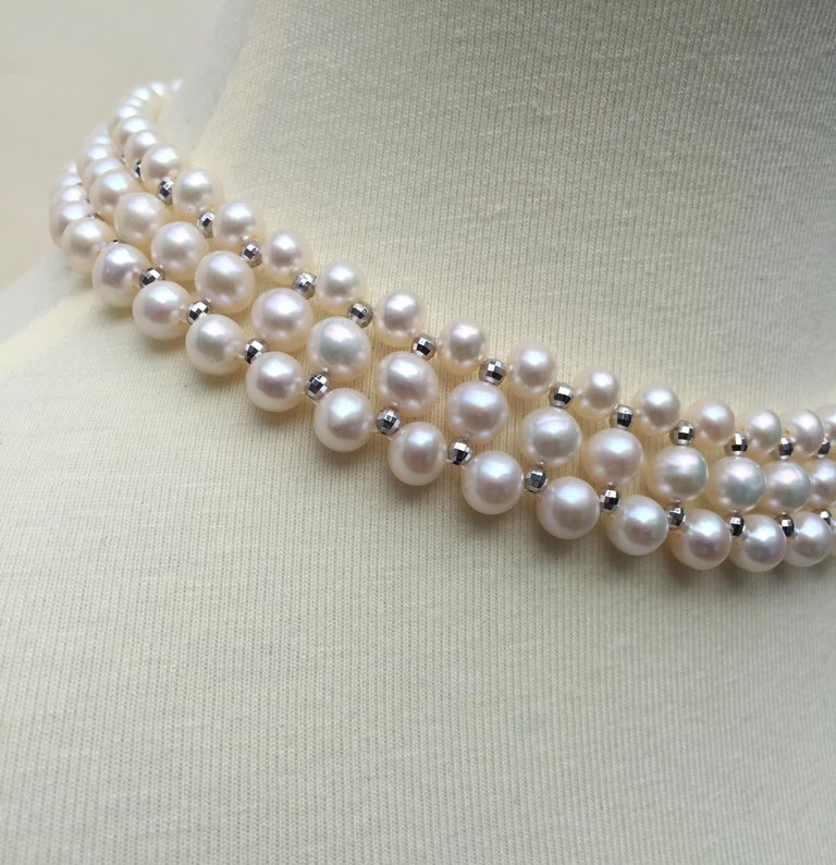 This woven white pearl necklace with 14k white gold faceted beads and sliding clasp glitters beautifully. This classic necklace is handmade by Marina J. with 14k white gold faceted beads and glowing white pearls woven together in an elegant design.