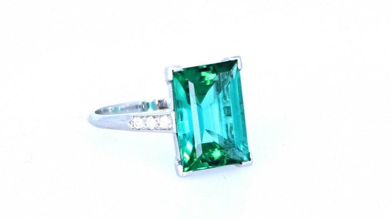 WOW Tiffany & Co Art Deco Irid Platinum Tourmaline & Diamond Ring 4.56 ctw 6g       Beautiful Tiffany & Co Art Deco irid platinum emerald cut ring.  Very elegant for everyday wear !! Natural green tourmaline!  Approx 0.06 ctw of G-H VS diamonds