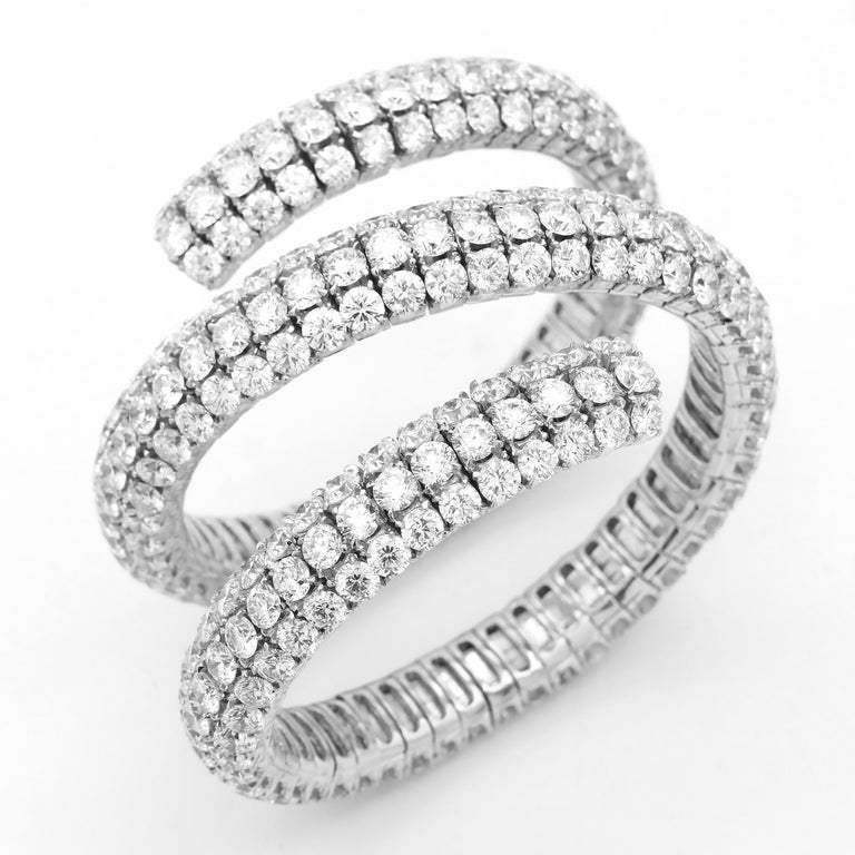 Wrap Around Flexible Bangle with 321 Round white diamonds and about 100 carats. Average color is GH and clarity is VS and Si. Heavy show stopper type of piece. Set in 18k White Gold.