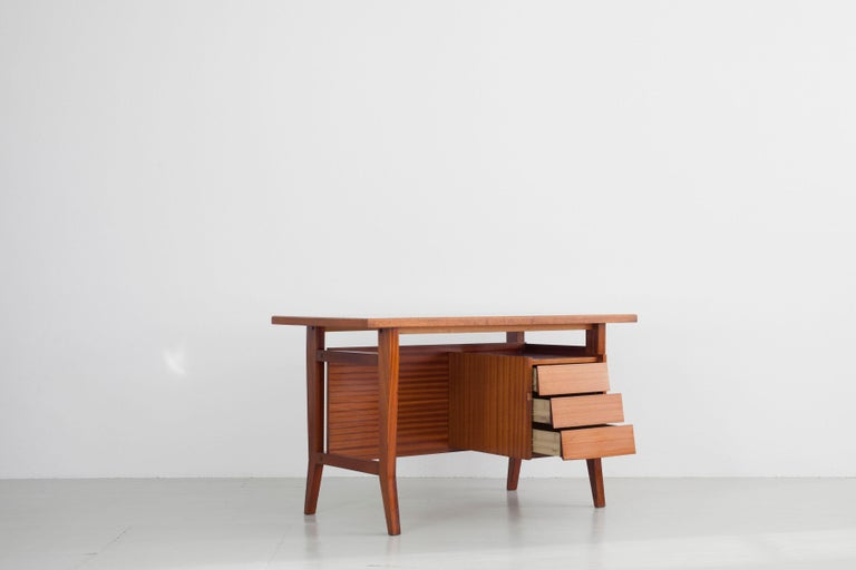 Writing desk designed by Gio Ponti / Schirolli, Italy, 1960s. This beautiful wooden writing desk of angular, linear shapes is in its original condition and features an integrated drawer element.