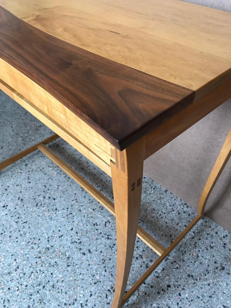 An interesting maple and walnut custom desk/console table with drawer by Byron Robitaille.