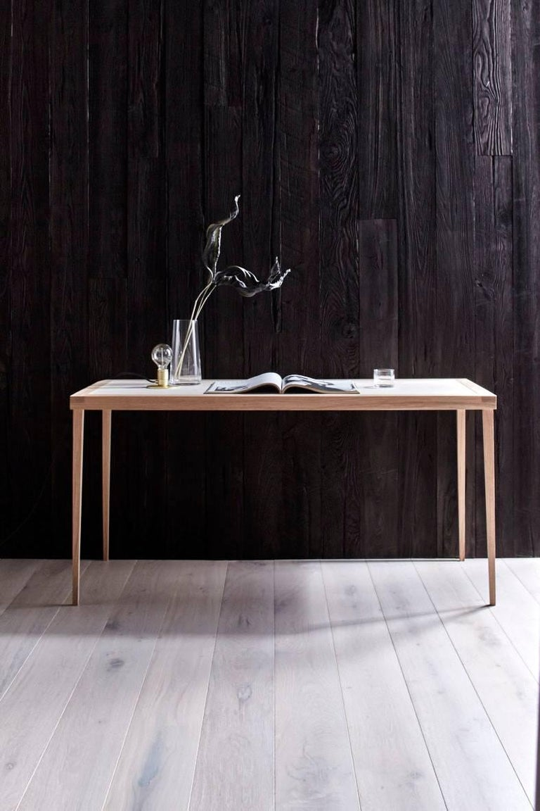 Deborah Ehrlich's simple writing table is handmade with traditional joinery by an incredibly talented master craftsman in RI.  The delicate proportions are a nod to the elegance of all her work, and it appears to be floating above the
